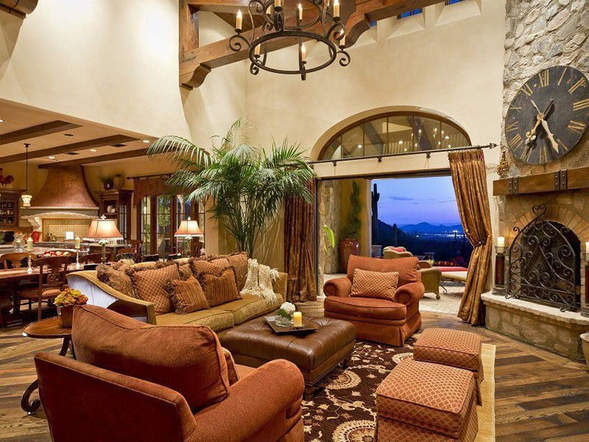 Luxury Mediterranean style living room with stone fireplace and amazing views