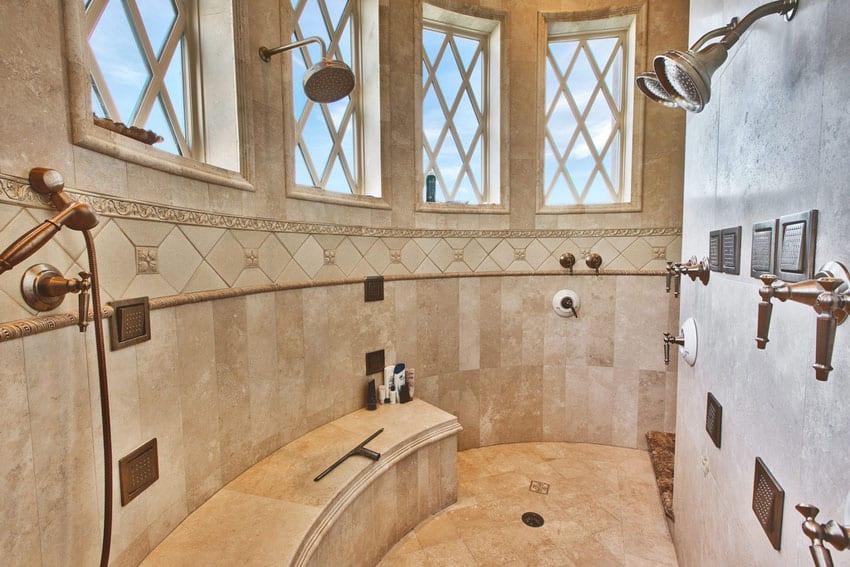 Luxury travetine shower with three showerheads