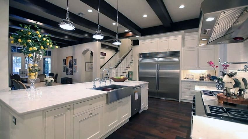 Luxury white shaker cabinet kitchen with open beams and chrome pendant lights