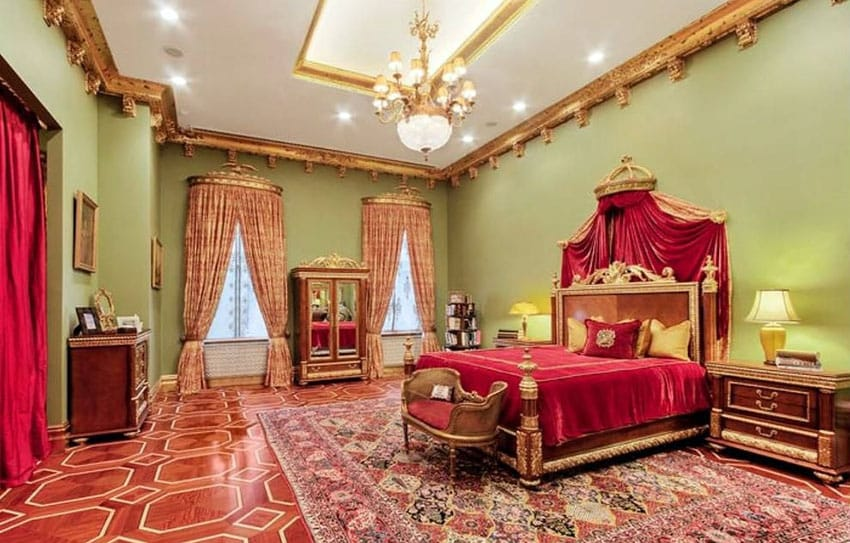 Majestic master bedroom with gold and red color decor and ornate moldings