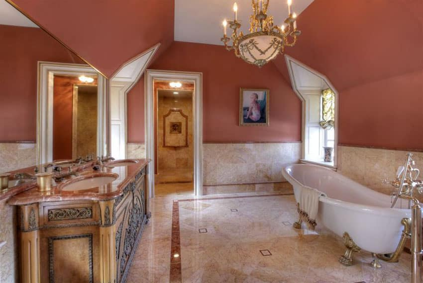 Master bathroom with clawfoot tub with lion paw feet