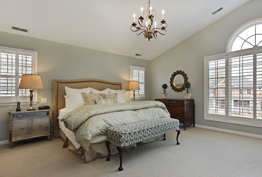 Master bedroom in luxury home with circular window