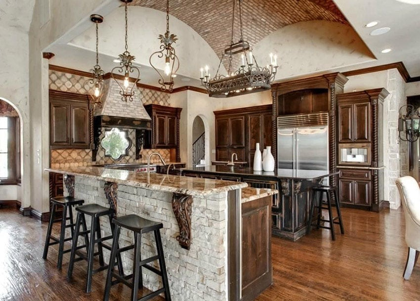 Mediterranean kitchen with dark decorative cabinetry