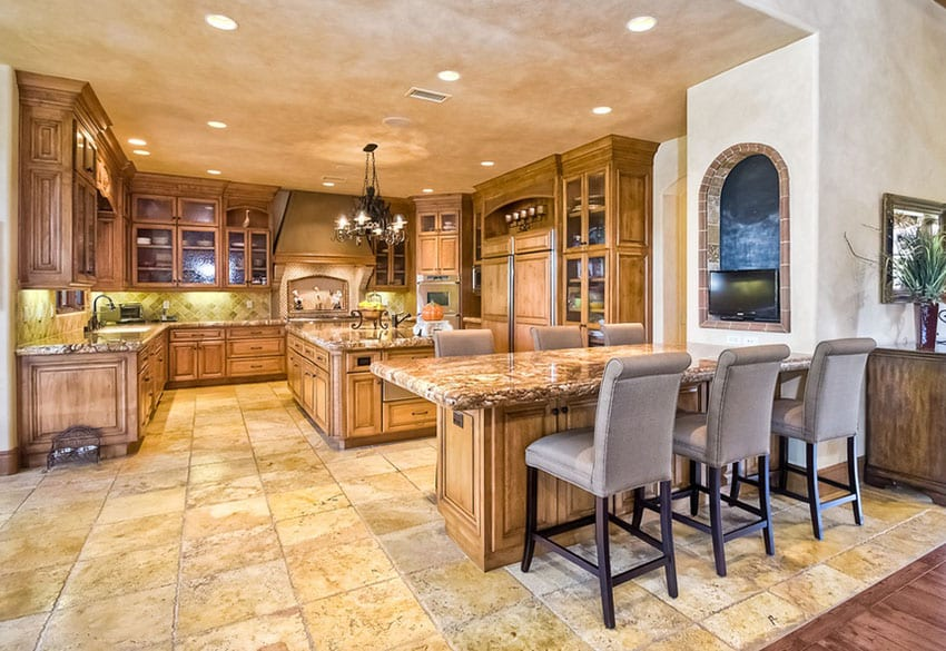 Mediterranean kitchen with u shaped design and large breakfast bar dining area