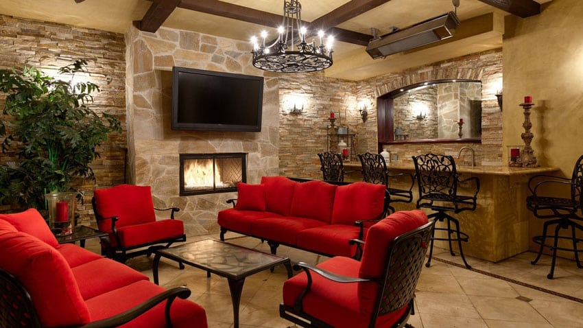 Mediterranean style custom home bar with gas fireplace and stacked stone walls