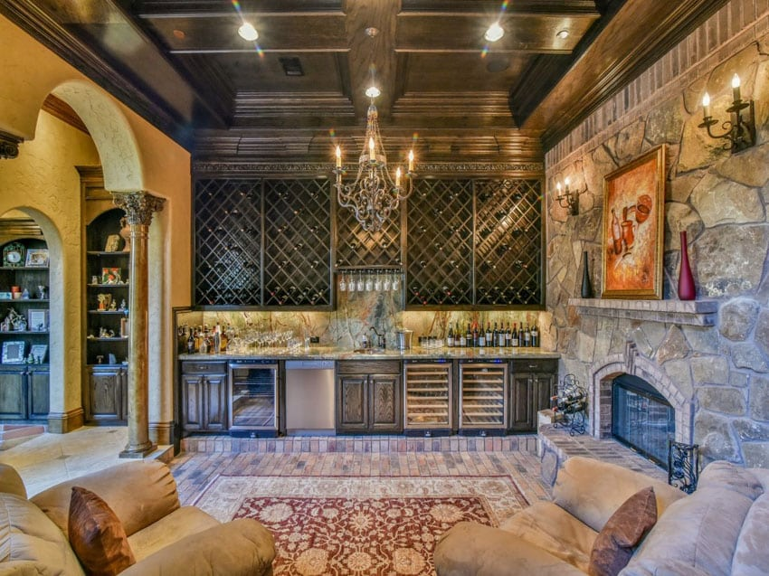 Mediterranean style home bar with wine storage