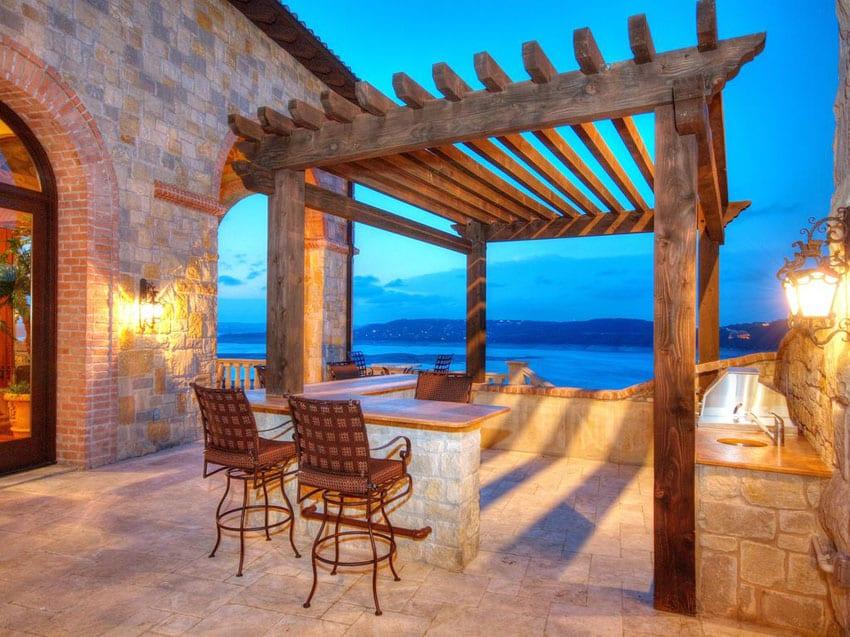 Mediterranean style patio with pergola and ocean views