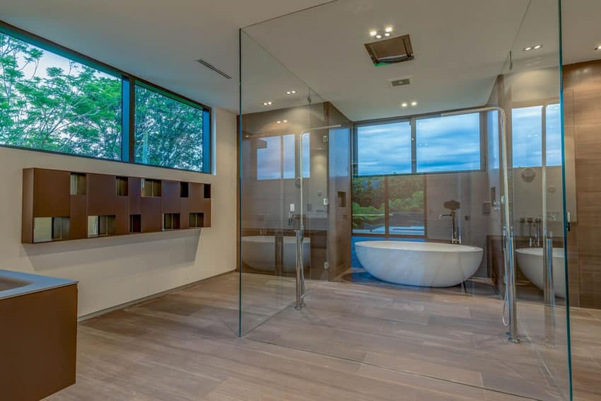 Modern bathroom with center shower with wraparound window views