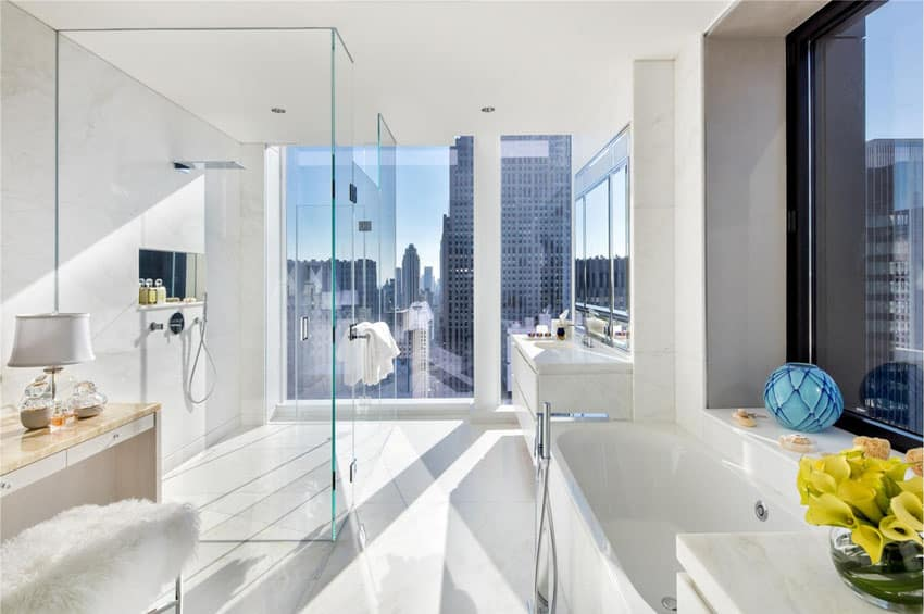 Modern bathroom with city view and frameless shower door