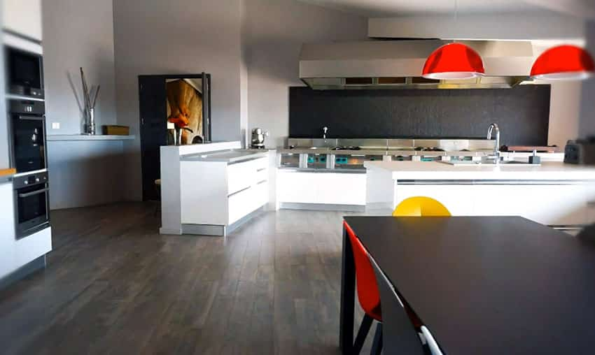 Modern kitchen and dining room with bright color accent pieces