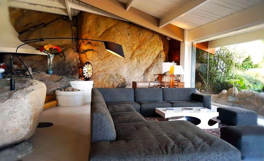 Modern living room design with real boulder wall