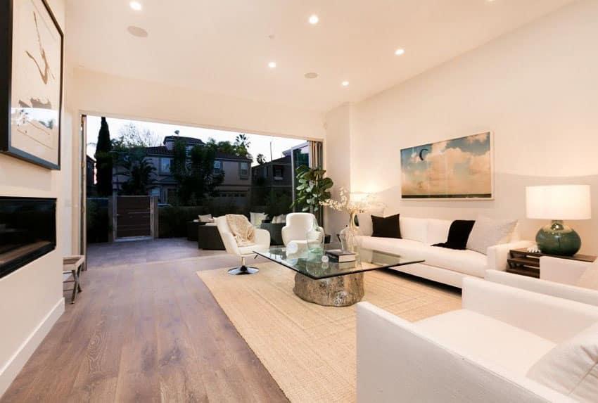 Modern living room with retractable doors to outdoor patio