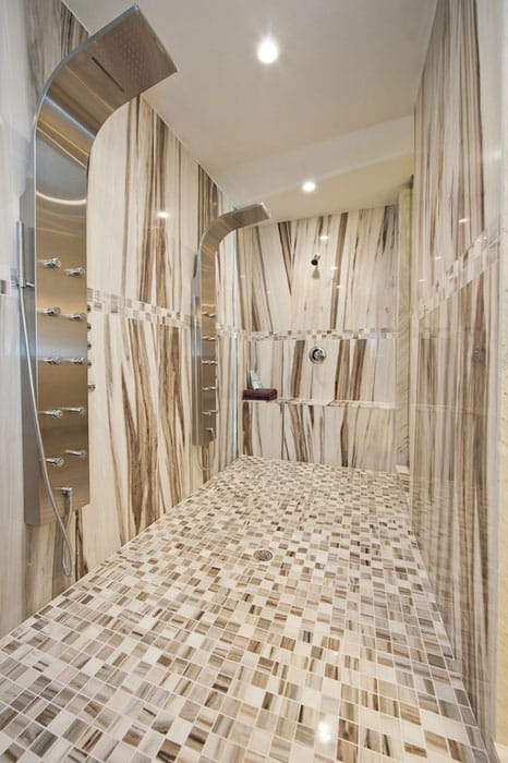 Modern luxury shower with marble floor tiles and multiple showerheads