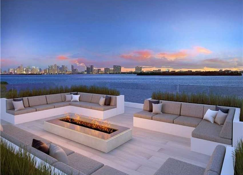 Modern patio with firepit and waterfront views of Miami