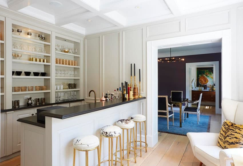 Eclectic white home bar with coffered ceiling