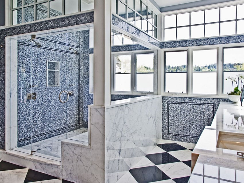 Mosaic and marble shower with lake views