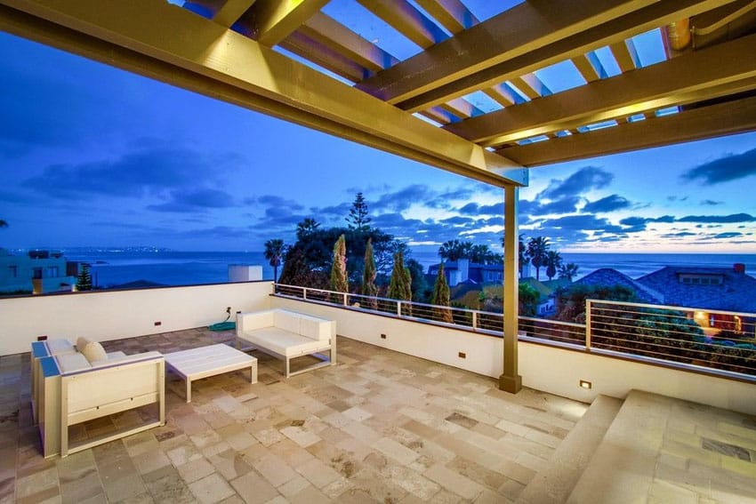 Ocean view patio with white outdoor furniture