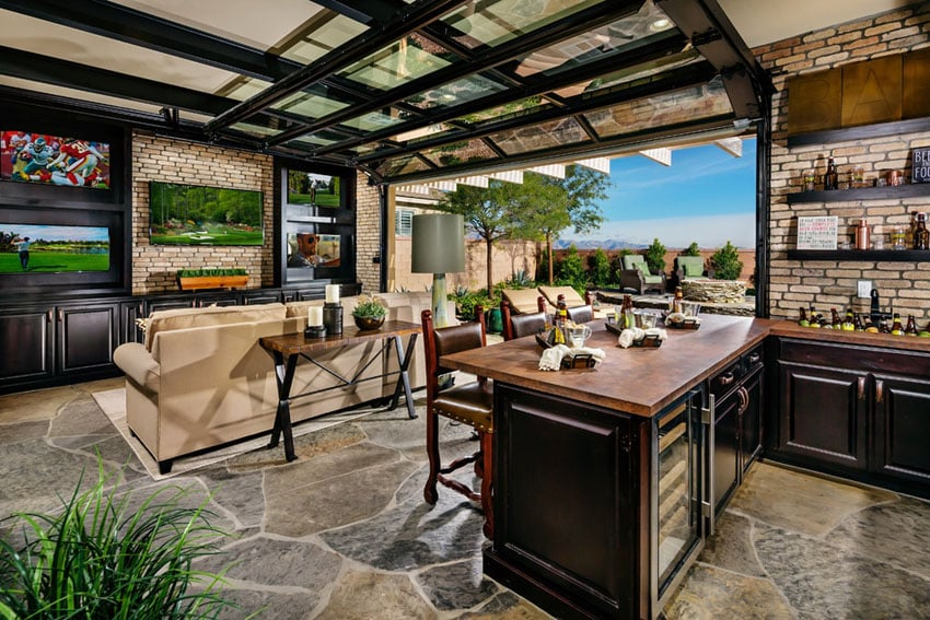 Open air home bar with retractable door to patio