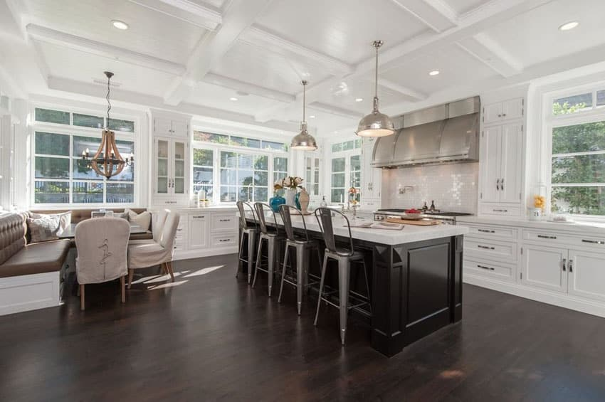 Open concept beach style kitchen with subway tile and chrome pendant lights