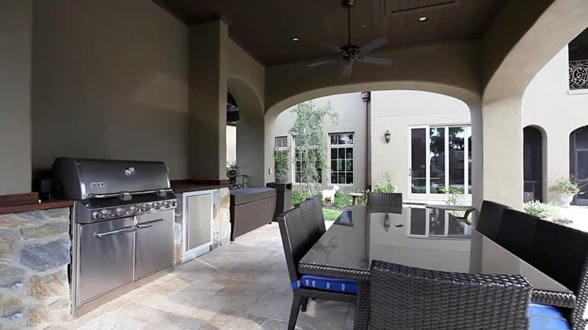 Outdoor kitchen with covered patio at custom estate home
