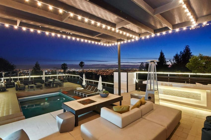 Patio with amazing city views and canopy with hanging lights