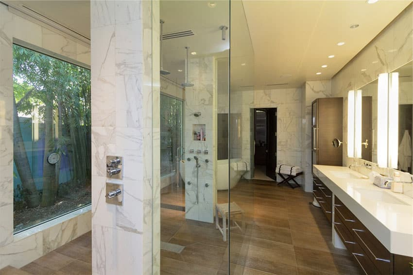 Rain shower with large picture window and marble walls