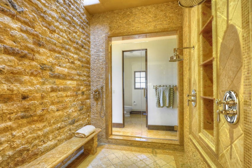 Rain shower with stone walls and tile floors