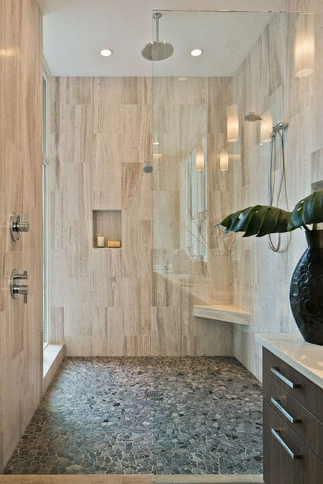 Rainfall shower with glazed porcelain wall tiles and pebble mosaic floor tile