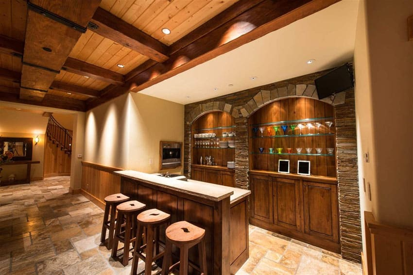 Rustic custom wood home bar with high ceilings
