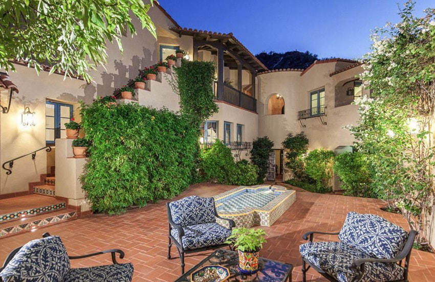 Spanish style patio with brick and metal furniture