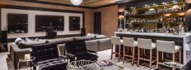 stylish-home-bar-with-lounge-seating-and-marble-counters