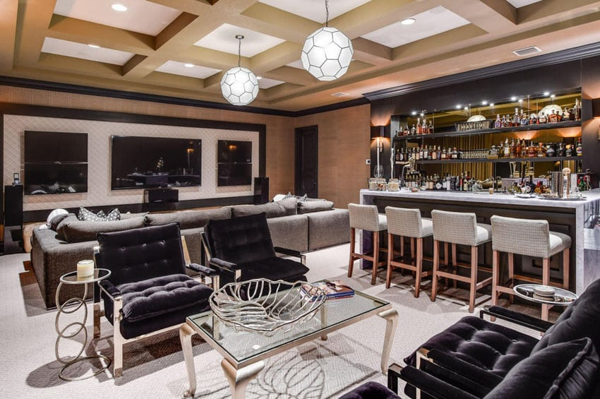 Stylish home bar with lounge seating and marble counters