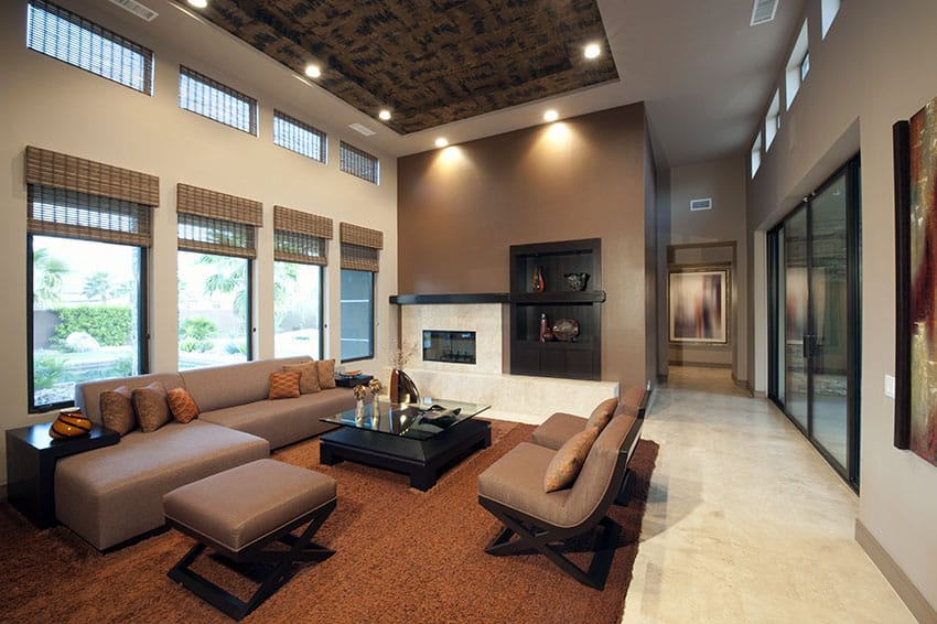 Stylish living room with high tray ceiling with interesting pattern