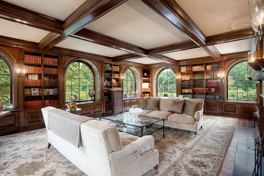 Traditional formal living room with wood built in bookcases and beam ceiling