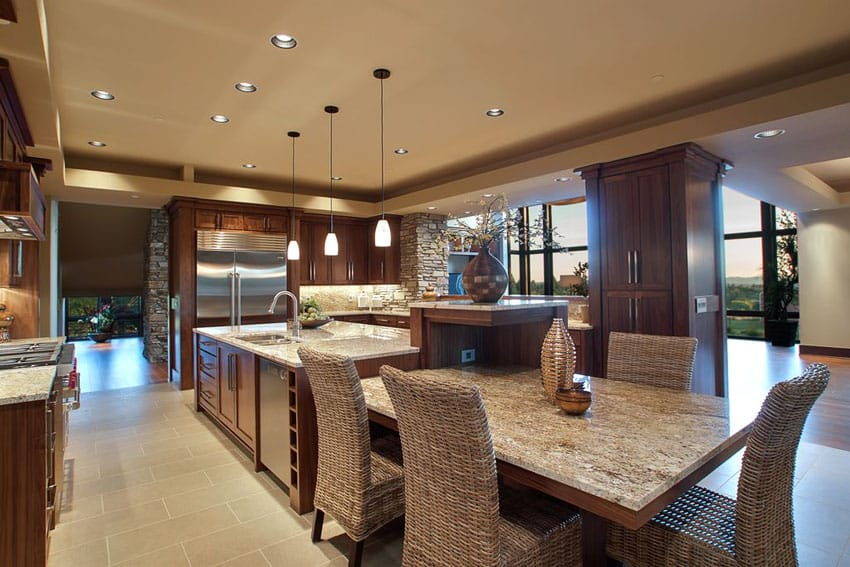 Traditional kitchen with almond gold granite and end breakfast bar