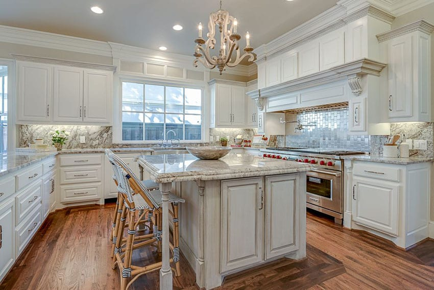 Traditional kitchen with white cabinets aspen white granite countertop and breakfast bar