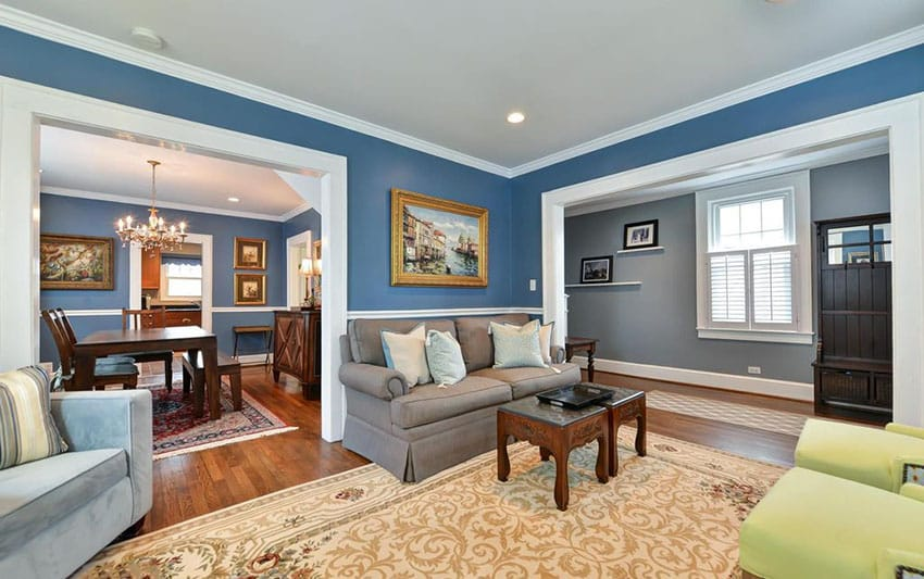 Traditional living room with crown molding and blue walls