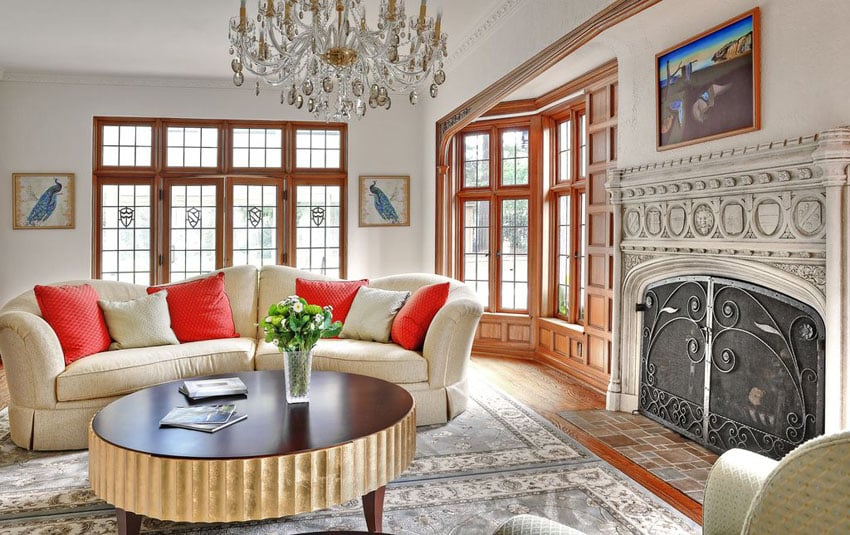 Traditional living room with high end custom wood windows and detailed fireplace