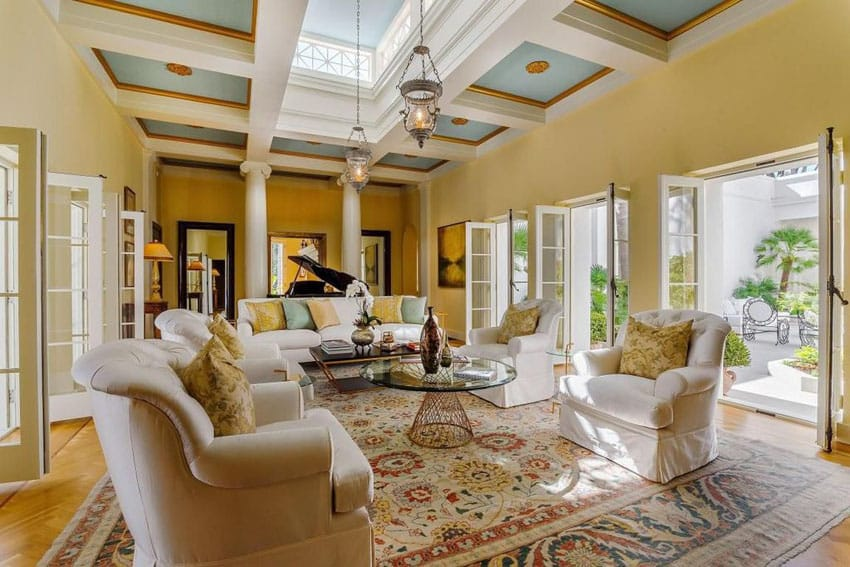 Traditional living room with mustard color paint and white and blue box ceiling