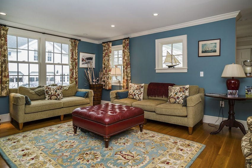 Traditional living room with navy walls and hardwood floors