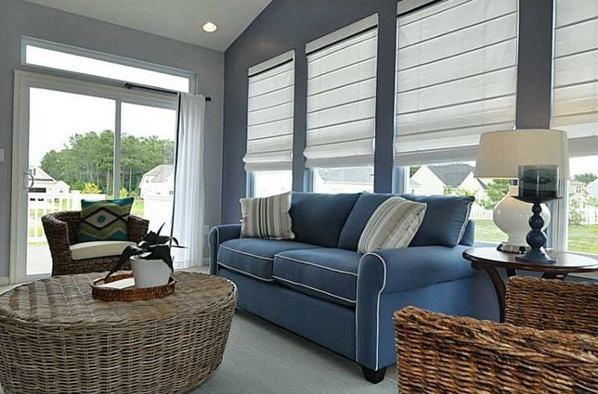 Traditional living room with wicker furniture and blue couch