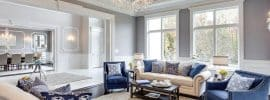 traditional-luxury-living-room-with-tray-ceiling-and-glass-chandelier
