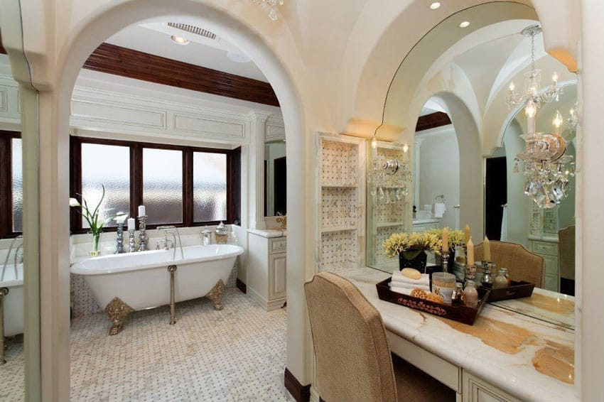 Traditional master bathroom with cast iron clawfoot tub with bronze feet