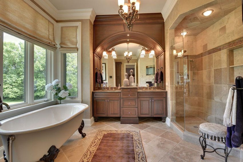 Traditional master bathroom with cast iron clawfoot tub with lion paw feet