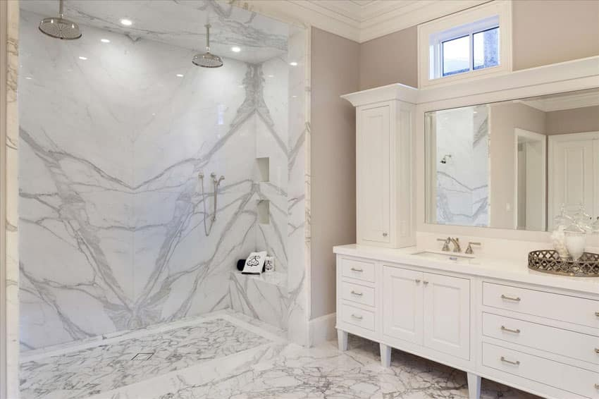 Traditional master bathroom with dual showerhead rainfall shower and white marble
