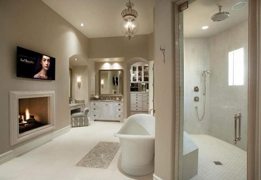 Traditional master bathroom with fireplace walk in shower and makeup counter