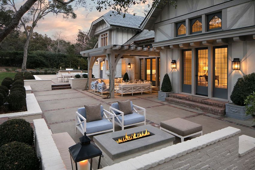 Traditional patio at luxury home with firepit and pergola