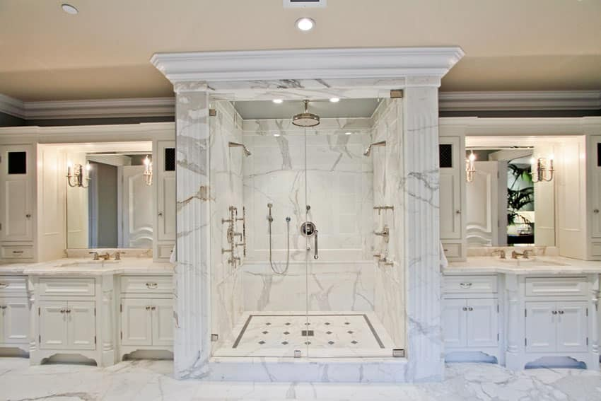 Traditional rain shower with white vanities and marble floors