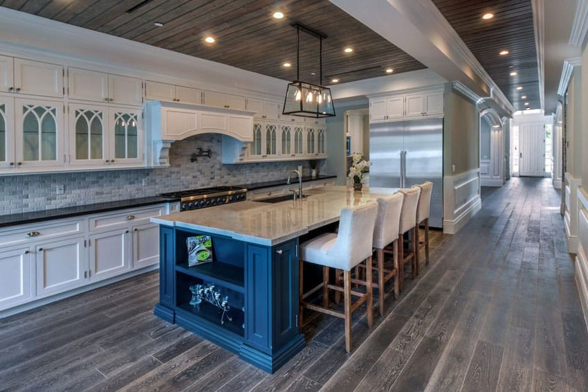 Traditional white cabinet kitchen with gray oak floors and carrara marble dining island