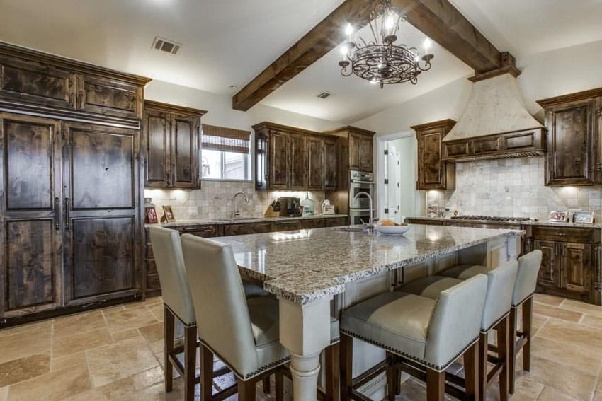 Traditional wood cabinet kitchen with large granite topped dining island